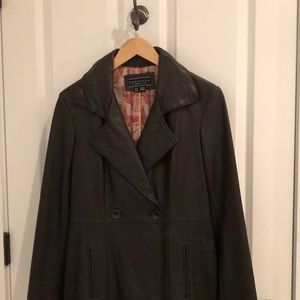 Leather trench coat. Never worn, stored correctly.